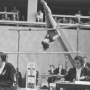 gynnast on uneven parallel bars