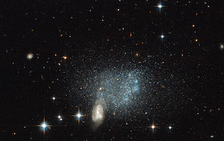 """Stars fleeing a cosmic crash"" by ESA/Hubble & NASA Acknowledgement: Luca Limatola - http://www.spacetelescope.org/images/potw1332a/. Licensed under Public Domain via Wikimedia Commons - http://commons.wikimedia.org/wiki/File:Stars_fleeing_a_cosmic_crash.jpg#mediaviewer/File:Stars_fleeing_a_cosmic_crash.jpg"